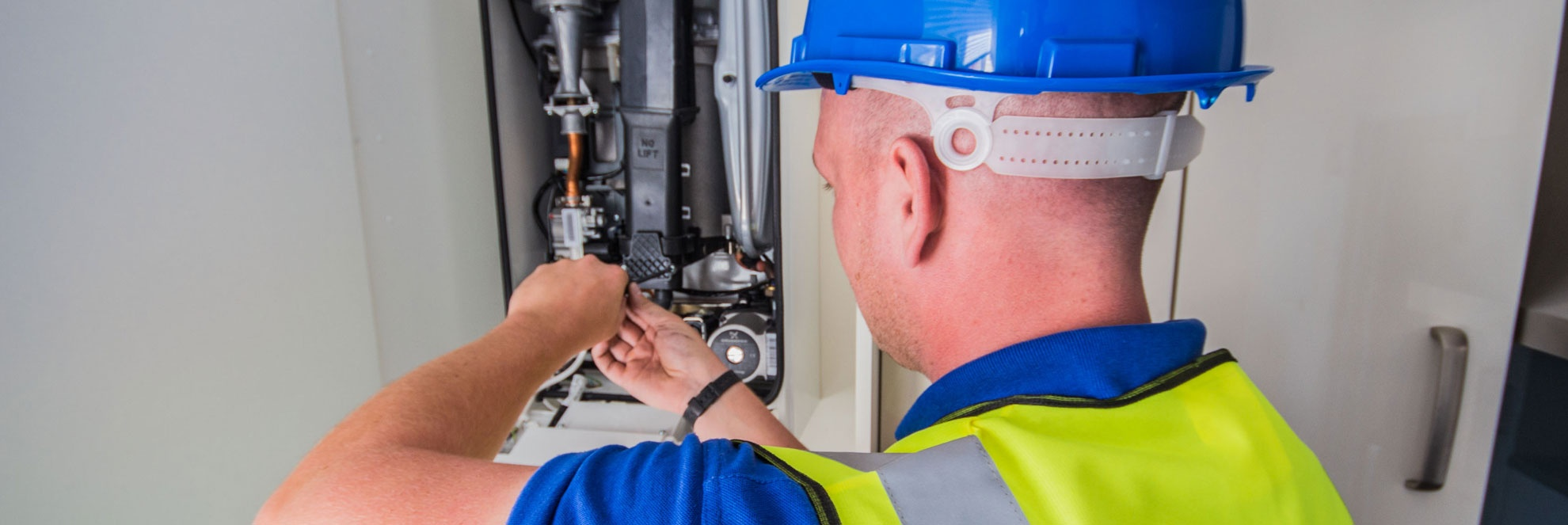 Boiler service and repair - Engineer repairing boiler